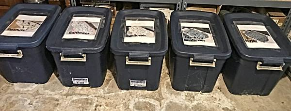 Birdseed Stored in Large Plastic Storage Containers